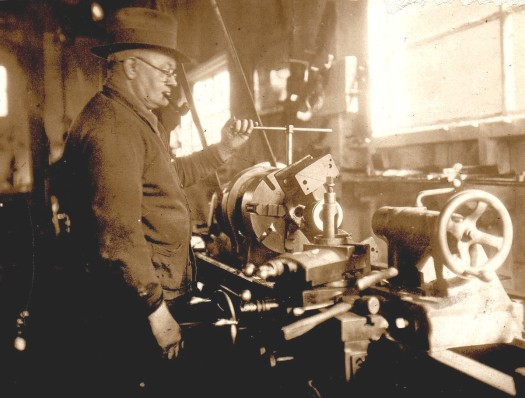 Photo of Henry McCartney in his machine shop.